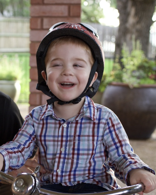 Joseph Hann rides his tricycle at his family's home in the Dallas area, a task he is no longer able to enjoy due to his deteriorating nervous system.
