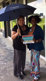 Susana Mendoza, Sr. Administrative Assistant, University Police (pictured with Nechelle Harris, Manager, University Police): We take cover under the shade of an umbrella!