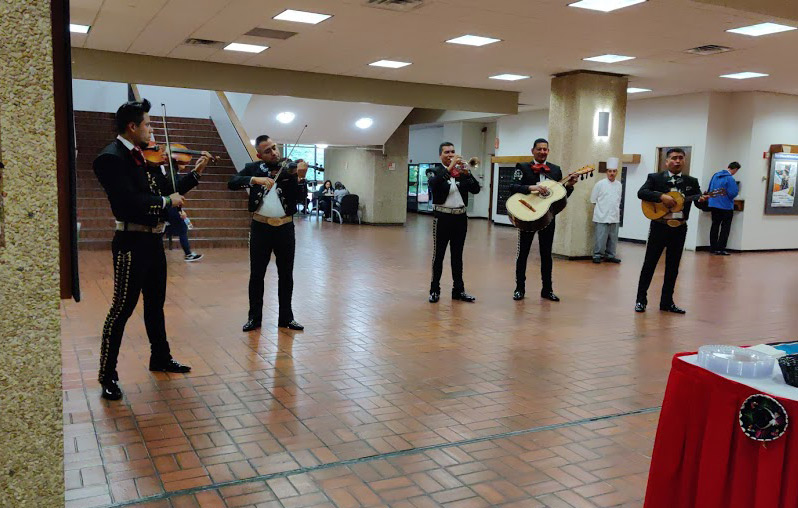 The crowd was entertained by performances from a mariachi band.