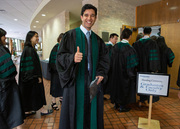 Thumbs up as students file in for the Hooding Ceremony.