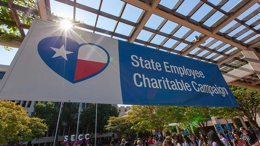 Banner with heart around Texas Flag that says State Employee Charitable Campaign
