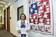 Amanda Evans, with Sunbonnet Sue's Stars and Stripes (Textiles and Fiber, Amateur, first place)