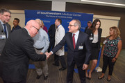 UT Southwestern President Dr. Daniel K. Podolsky shakes hands with Dallas artist John Pomara, a Professor in the School of Arts and Humanities at UT Dallas.