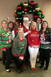 Victoria England - The Office of Nurse Excellence (O.N.E.) helped make this rainy day so festive that Santa showed up.