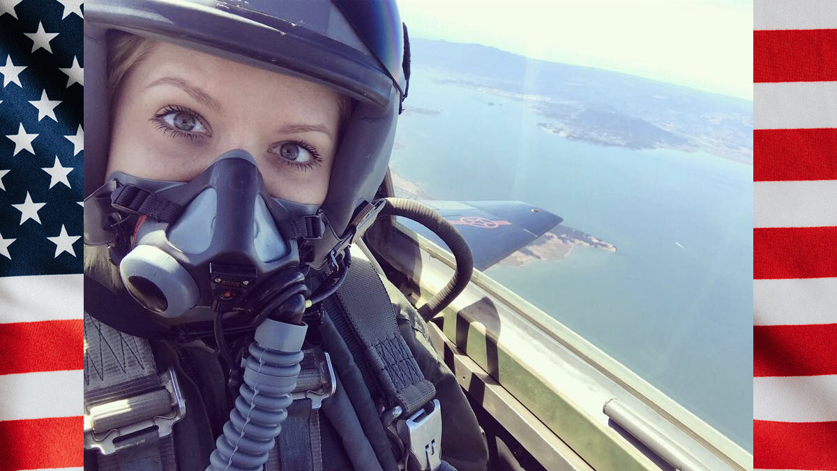 Woman in figher jet with helmet and oxygen mask on