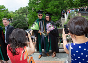 Students pack McDermott Plaza after the ceremony and document the day in photos.