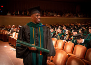 Dr. Yemi Afuwape, an M.D./Ph.D. graduate, with diploma in hand.