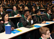 Students listen closely to instructions ahead of the Hooding Ceremony, which is a symbolic acknowledgment by the faculty to students who have attained a certain level of scholarly achievement.