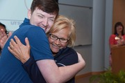 Nursing Resident Zechariah Thompson andClinical Educator Kathie Waldron share a hug at the July graduation ceremony.