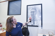 Mary Heather Fyfe clowns around with her portrait of Dr. Claus Roehrborn.