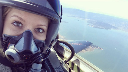 Woman in jet wearing helmet and mask
