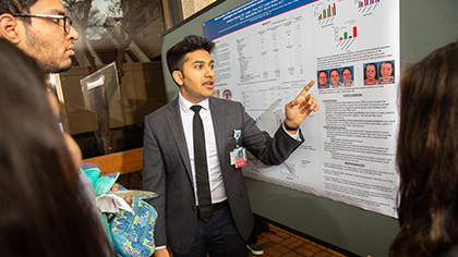 Student presenting poster submission