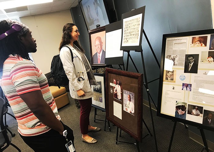 Students view display honoring Dr. Lee Henry