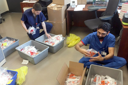 Group of medical workers sorting test kits