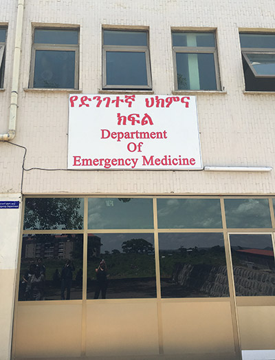 Building with a sign that reads Department of Emergency Medicine