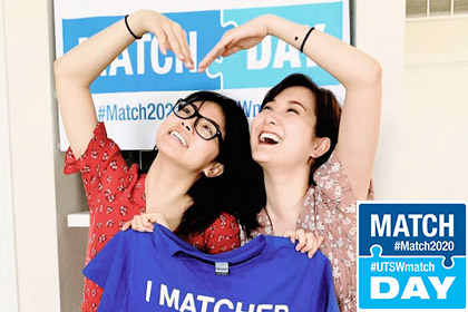 Two women smiling with an I matched shirt