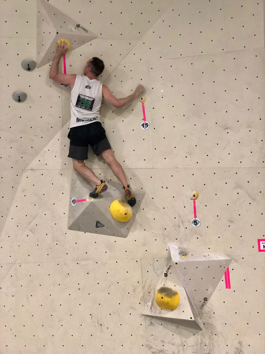 Man climbing rock wall
