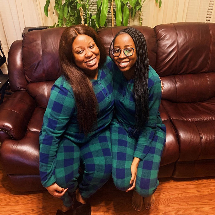 Two women in green and blue pajamas