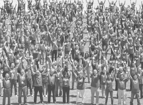 crowd of people with arms raised