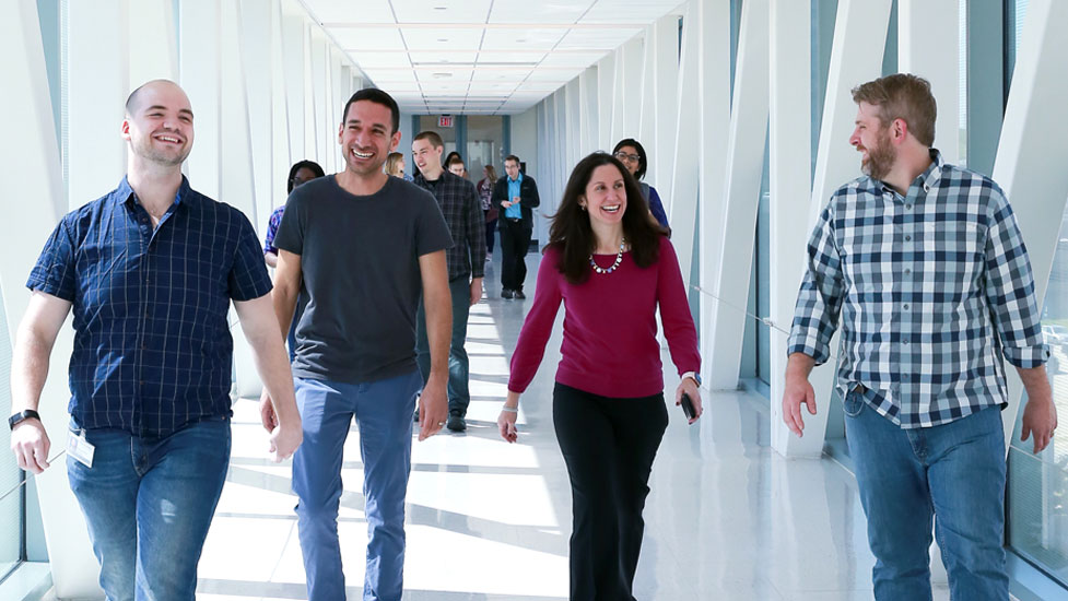 Students walking and laughing in the hallway