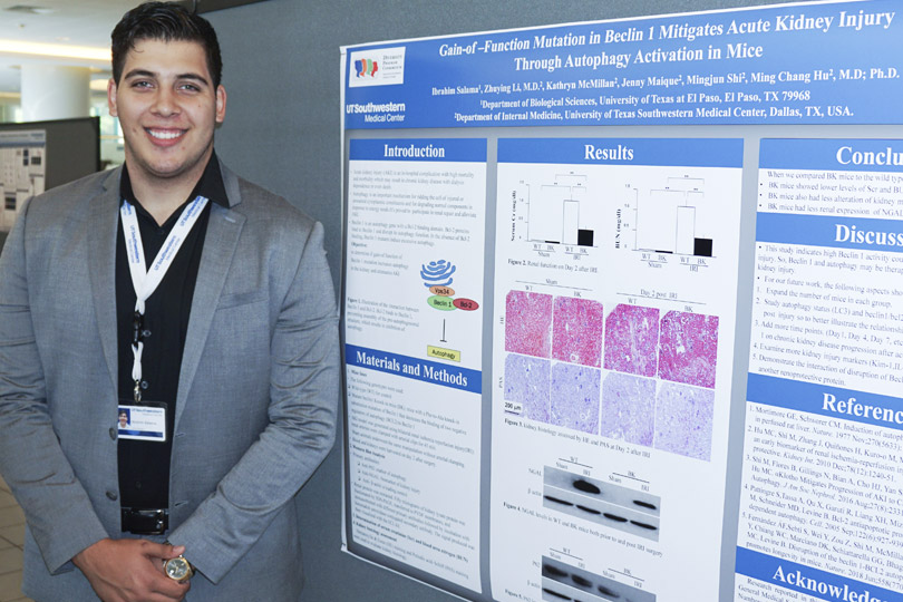A student stands with his poster that is titled Gain-of-Function Mutation in Berlin 1 Mitigates Acute Kidney Injury Through Autophagy Activation in Mice