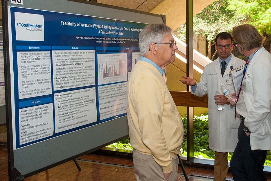 Dr. Michael Brown observing poster