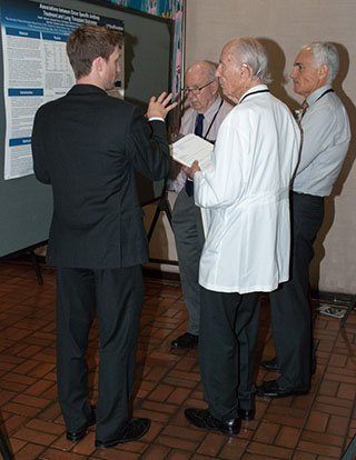 Dr. Donald Seldin judges a resident poster
