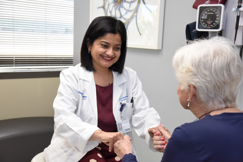 image of Dr. Anupama Gangavati with clinic patient