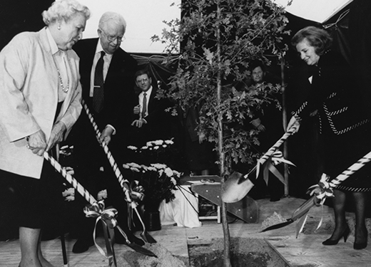 Dignitaries breaking ground with ribbon-decorated shovels