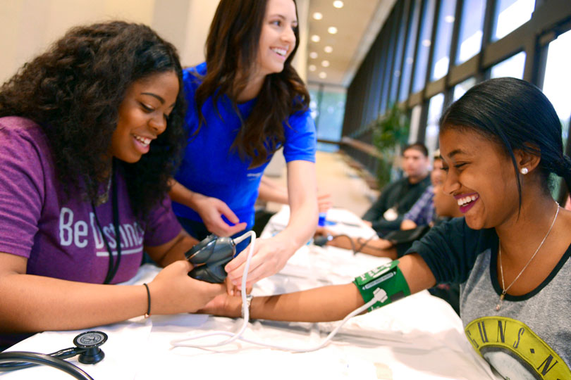 HPREP student takes another girl's blood pressure