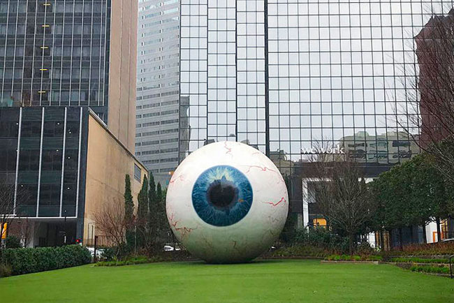 Huge eyeball sculpture on lawn in downtown Dallas
