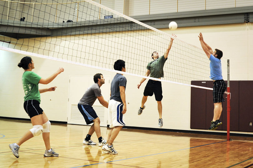 Students play an intramural volleyball game