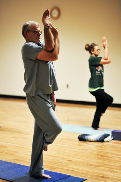 Dr. David Scott Miller takes in a yoga class
