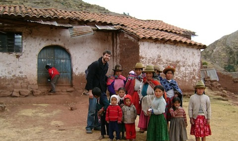 Tommy Heyne '12, with people in Peru