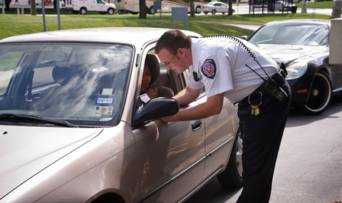 Parking Services officer giving directions to a motorist.