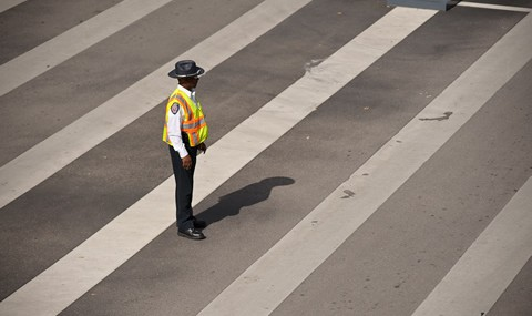 Officer in crosswalk at UT Southwestern.