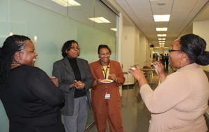 Layla Bushnell, Senior Administrative Associate, talks with colleagues at Neurology Open House.