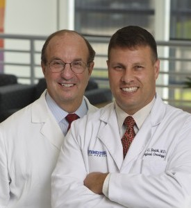 The Balches—father Charles and son Glen—work side by side as surgical oncologists in the Harold C. Simmons Comprehensive Cancer Center.