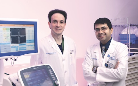 (Dr. Pietro Bajona (left), Dr. Amit Banga, Assistant Professor of Internal Medicine, and the rest of the EVLP team assessed the lungs using new ex-vivo lung perfusion technology.