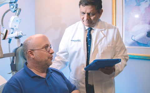 Dr. Madhukar Trivedi (right) confers with one of the patients who took part in a recent study that identified biomarkers for hypersomnia