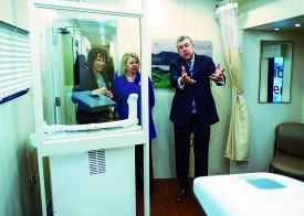 Dr. Keith Argenbright, Director of UT Southwestern's Moncrief Cancer Institute, provides a tour of the Mobile Cancer Survivor Clinic, which will serve cancer survivors in nine rural North Texas counties.