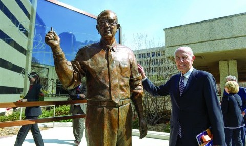 Dr. Donald W. Seldin stands beside a statue of himself unveiled in his honor at the dedication of the Dr. Donald Seldin Plaza, located on the South Campus, in March 2015.