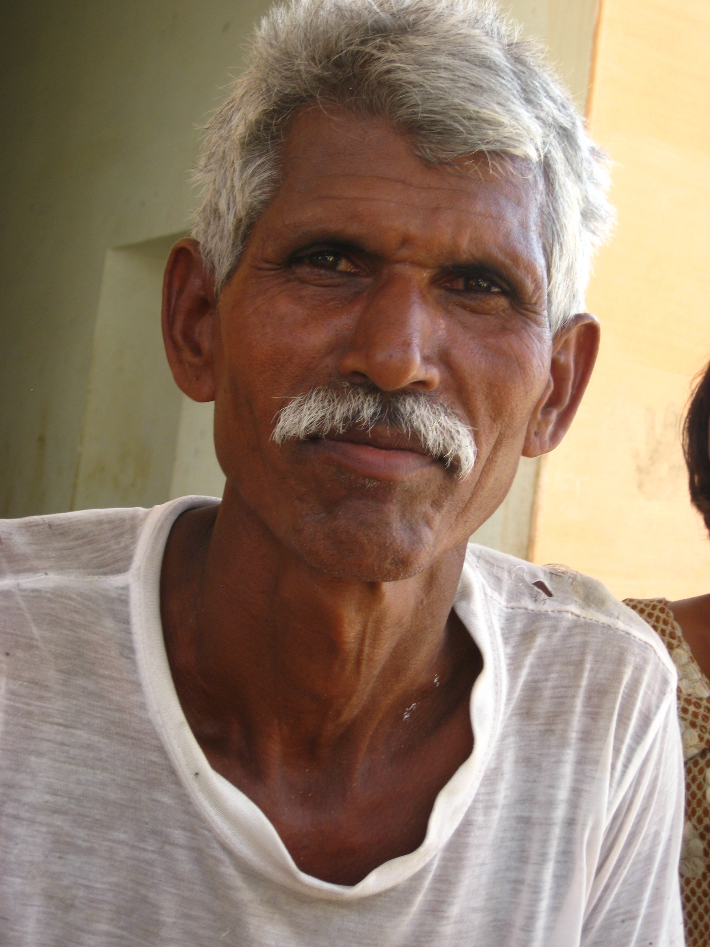 Older man in t-shirt with gray hair and mustache