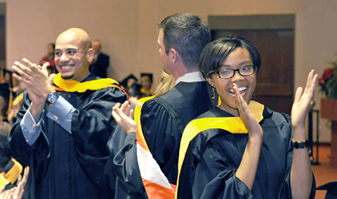 Graduates of the UTSW School of Health Professions celebrate at commencement.