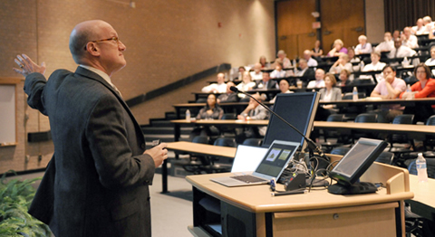 Dr. Bruce Meyer tells attendees of a recent Faculty Assembly meeting that UT Southwestern has plan-ned well for future changes to national health care policy.