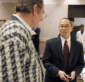 Dr. George Liu (right) talks with Dr. Gerald Casenave, Associate Professor of Rehabilitation Counseling and a fellow Senate member, at a recent Faculty Senate meeting.