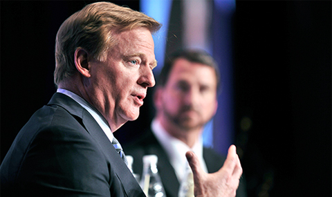 NFL Commissioner Roger Goodell, sharing the stage with CBS sports anchor and former Dallas Cowboys quarterback Babe Laufenberg, makes a point during the 2014 Paul M. Bass Neurosurgery Symposium on Traumatic Brain Injury.