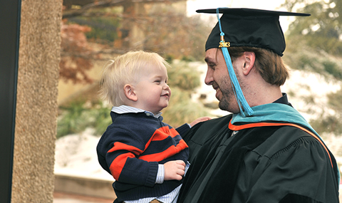 A proud Jason Jr. celebrates with his dad, Doctor of Physical Therapy graduate Jason R. Wishin Sr.
