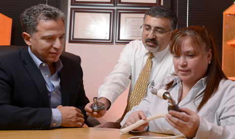 Drs. Sadek, Mammen, and Canseco examine two models of left ventricular assist devices.