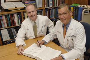 Drs. Patrick Clagett (right) and Greg Modrall collaborated on a retrospective study of patient outcomes, published in this month's <em>Journal of Vascular Surgery</em>.